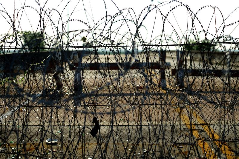 Barbed tape or razor wire royalty free stock photos