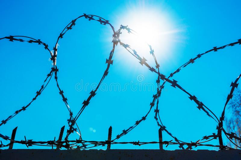 Barbed wire against a blue sky. royalty free stock photo