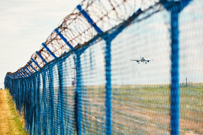 Barbed wire around airport royalty free stock photography
