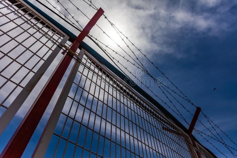 Barbed wire. And blue sky stock photography
