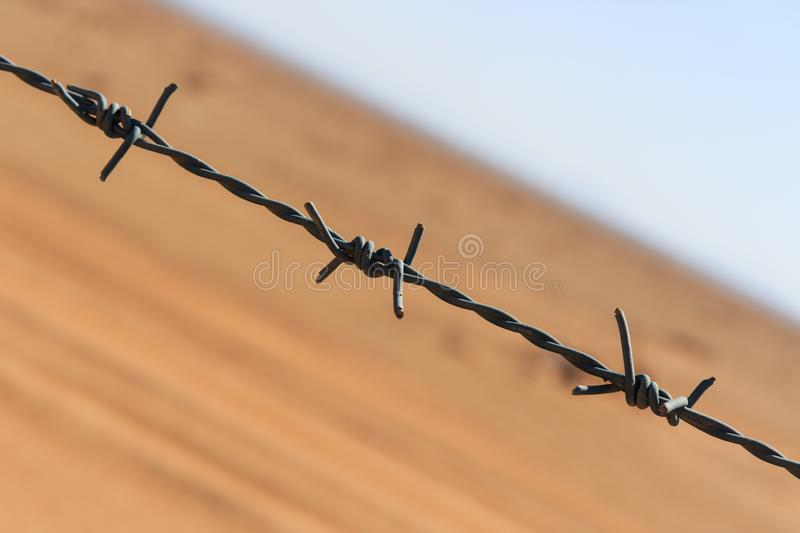 Barbed wire. In the desert royalty free stock photos
