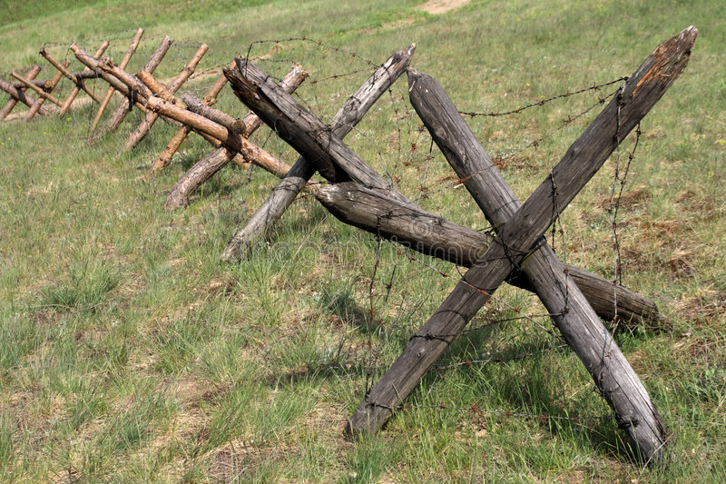 Barbed wire barrier stock photos
