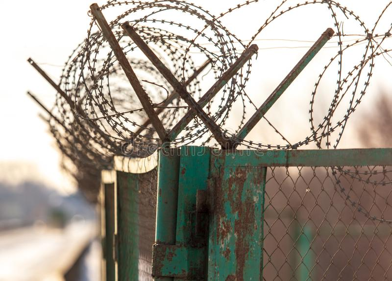 Barbed wire on the fence royalty free stock image