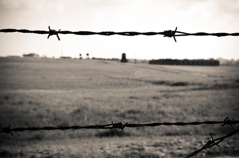 Barbed wire fence in concentration camp editorial stock