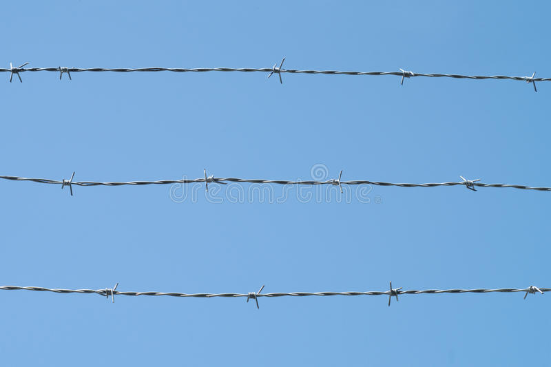 Barbed Wire Fence Forbidden Prohibited Boundary Security On Blue Sky ...