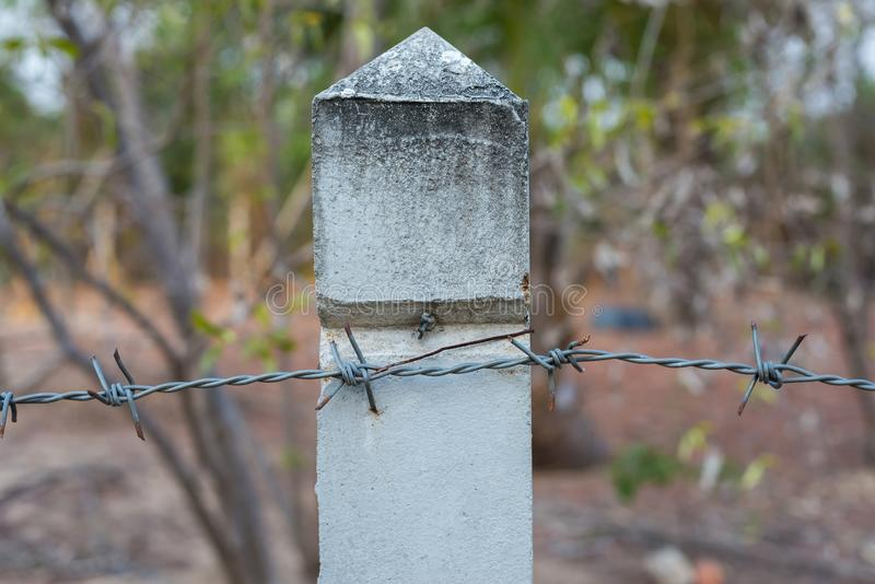 Barbed wire with pole stock images