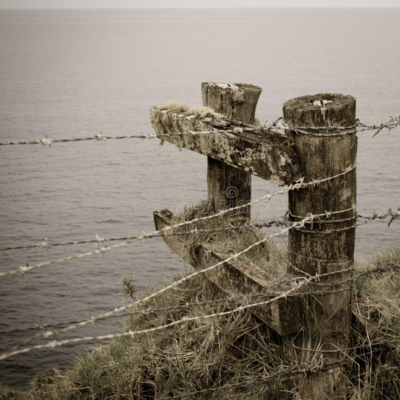 Barbed wire fence and posts, Norfolk Island stock image