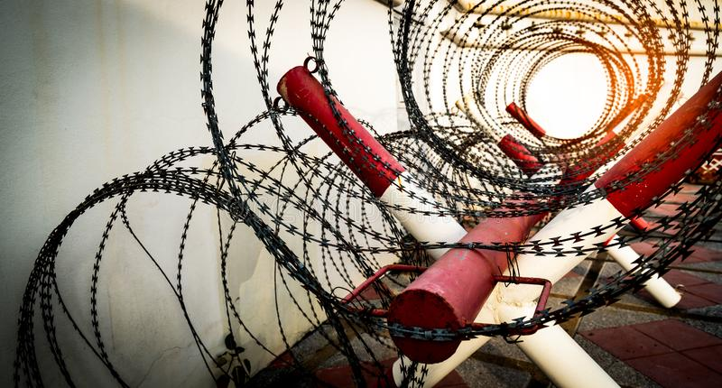 Barbed wire fence. Prison or jail wall. Security system. Private zone or danger military zone. Forbidden gate or entrance. stock images