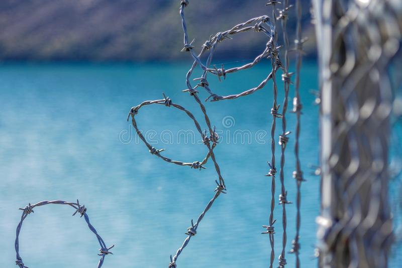 Barbed wire fence for protection at Lake Coleridge, New Zealand.  royalty free stock photos