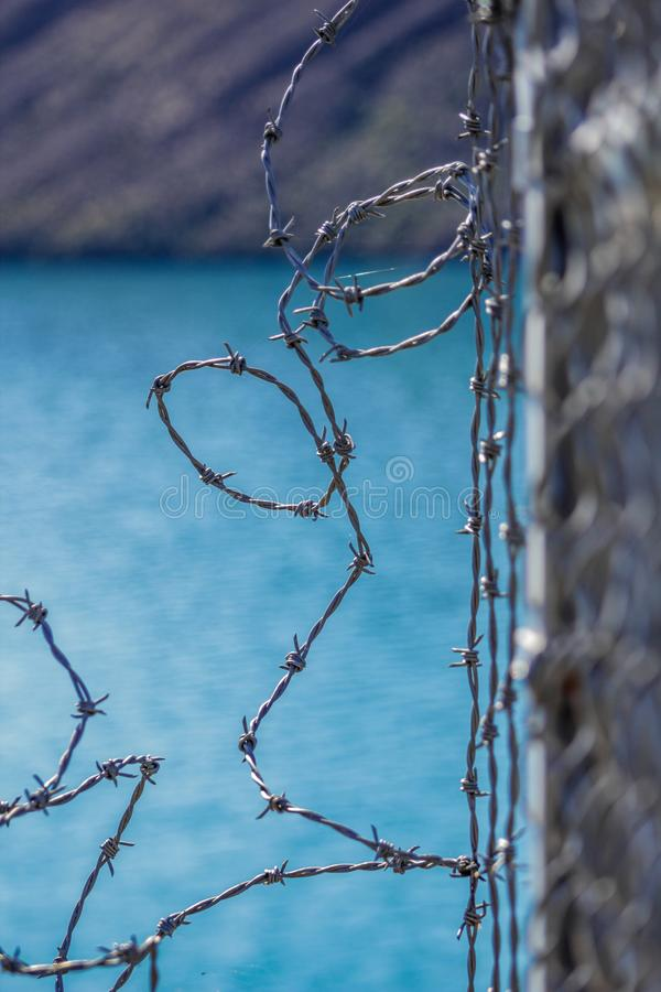 Barbed wire fence for protection at Lake Coleridge, New Zealand.  stock photos