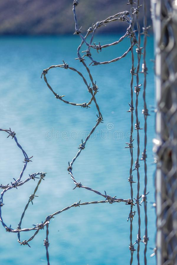 Barbed wire fence for protection at Lake Coleridge, New Zealand.  stock images