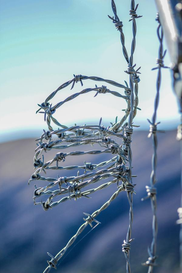 Barbed wire fence for protection at Lake Coleridge, New Zealand.  royalty free stock photography