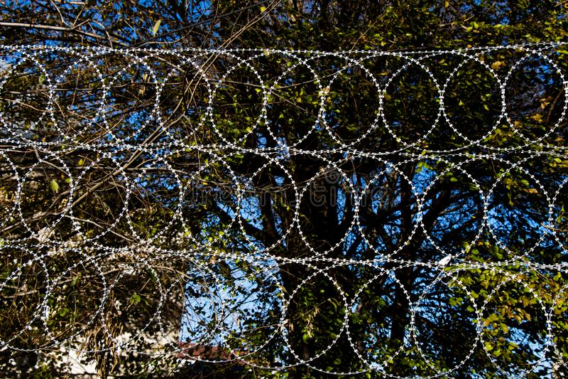 Barbed wire fence for protection purposes of a pproperty. Barbed wire fence used for protection purposes of a pproperty stock photo