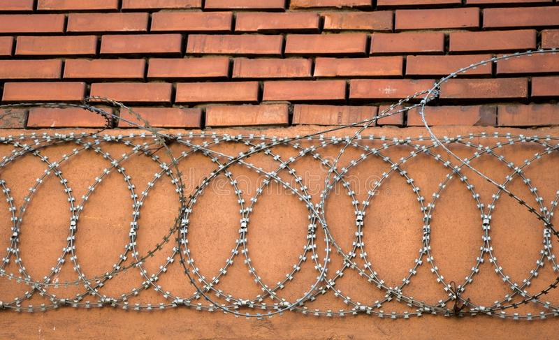 Barbed wire fence  for protection purposes of a pproperty. Barbed wire fence  used for protection purposes of a pproperty stock image