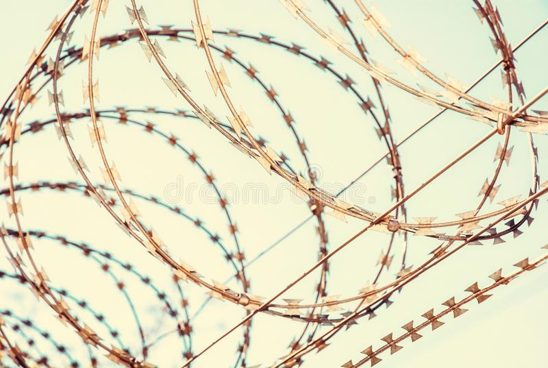Barbed wire fence for protection, retro filter. Barbed wire fence for protection. Entry ban. Retro photo filter royalty free stock images
