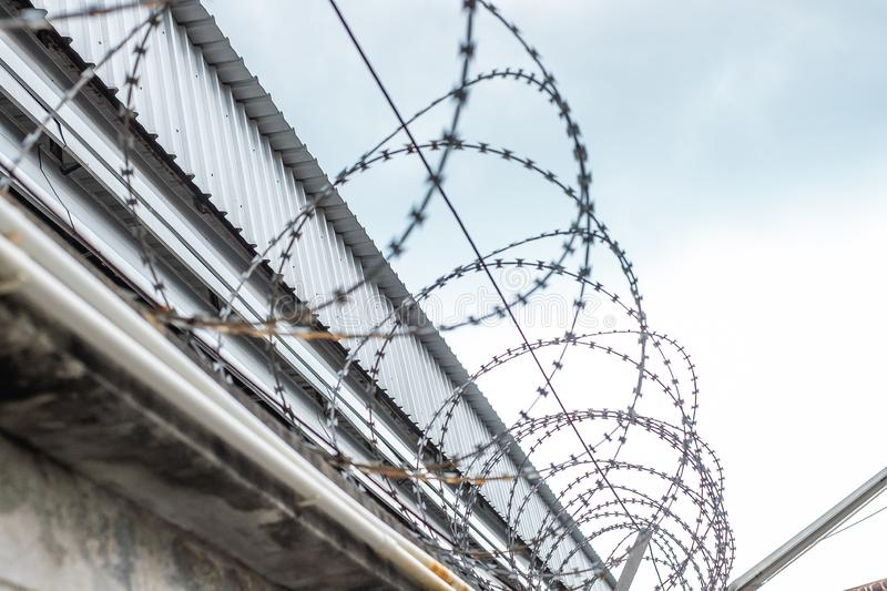 Barbed wire fences installed on the wall to protect the area royalty free stock photography