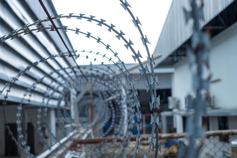 Barbed wire fences installed on the wall to protect the area. From thieves or prevent prisoners escape royalty free stock photo