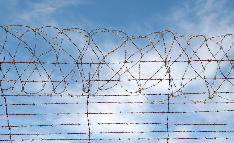 Barbed wire jail or gaol fence royalty free stock image