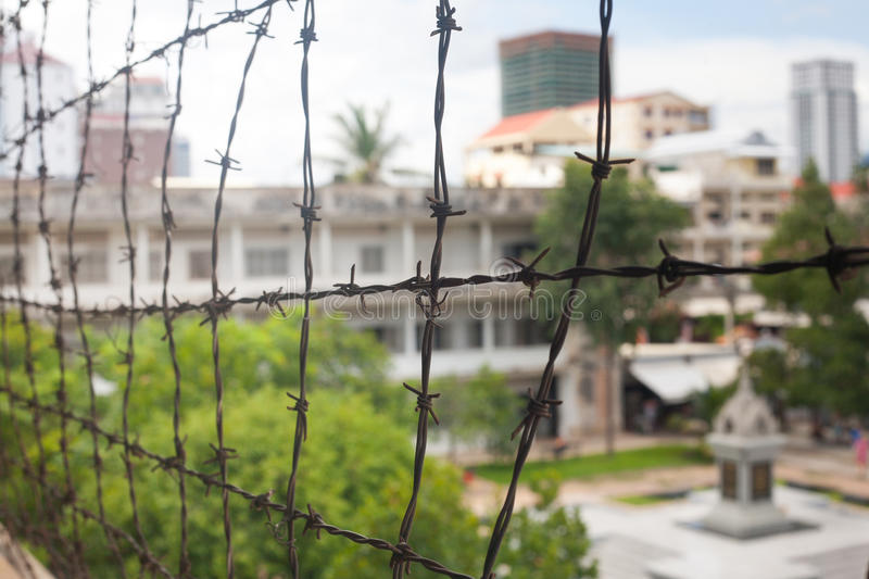 Barbed wire in memorial prison museum building in Cambodia close stock photo