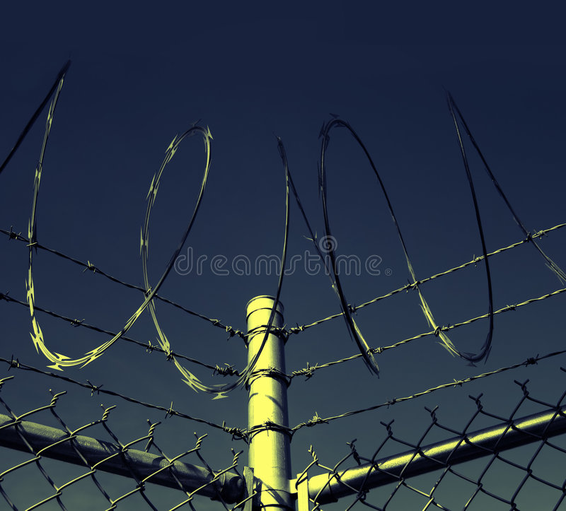 Barbed wire Security Fence. At high risk at national border royalty free stock photos