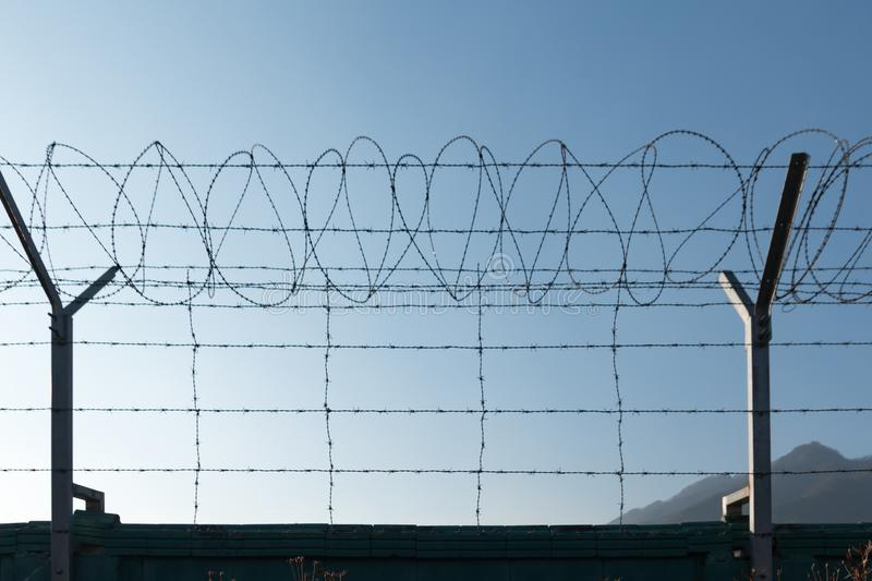 barbed wire, steel fencing wire with sharp edge royalty free stock images