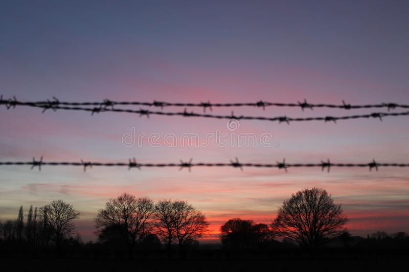 Barbed Wire Sunset Silhouette stock photos