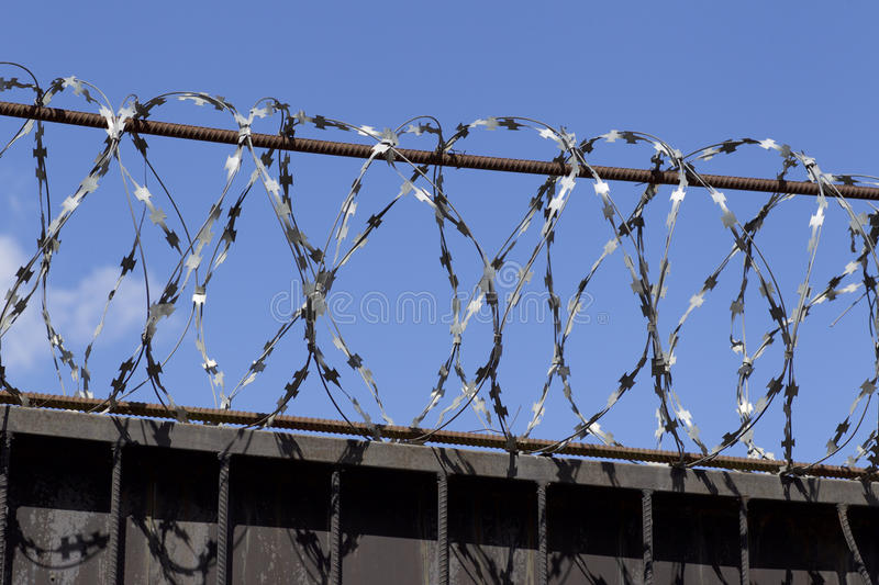 Barbed Wire Wound To The Top Of A Fence Stock Photo - Image of ...