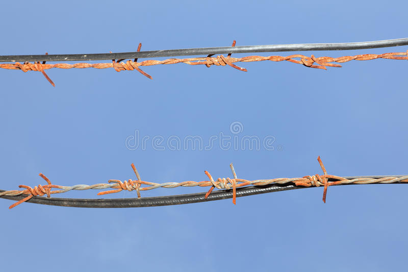 Barbed wires in sky