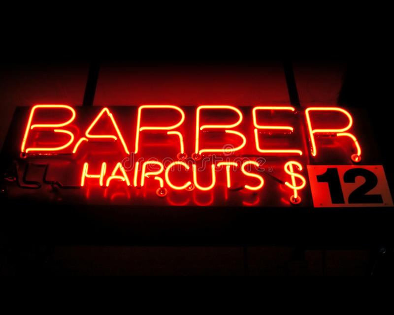 Barbeiro - sinal de néon dos cortes de cabelo imagem de stock