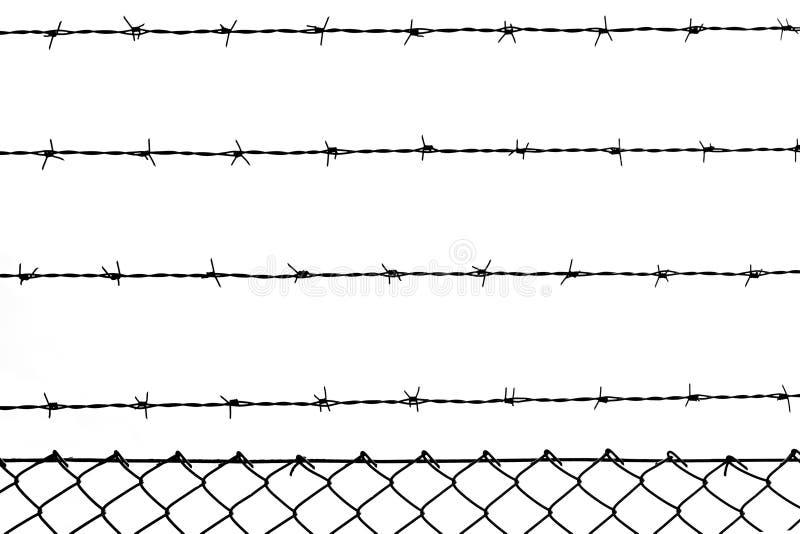 Barbelé contre éclairé photographie stock libre de droits