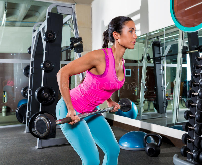 Barbell bent over row supine grip woman workout royalty free stock photos
