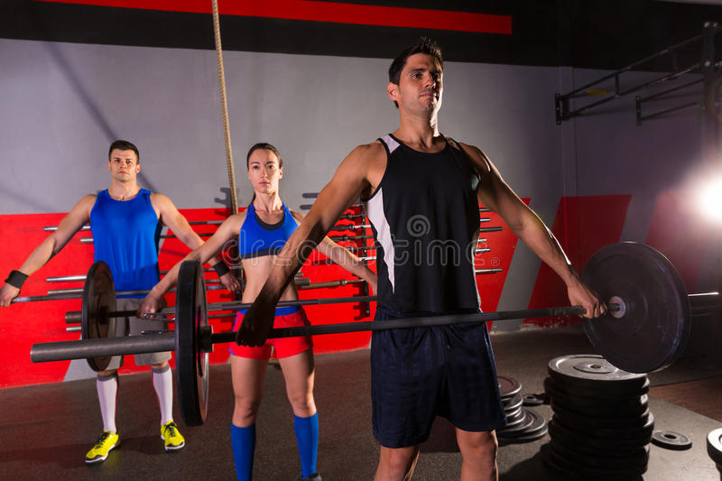 Barbell weight lifting group workout exercise gym royalty free stock photos