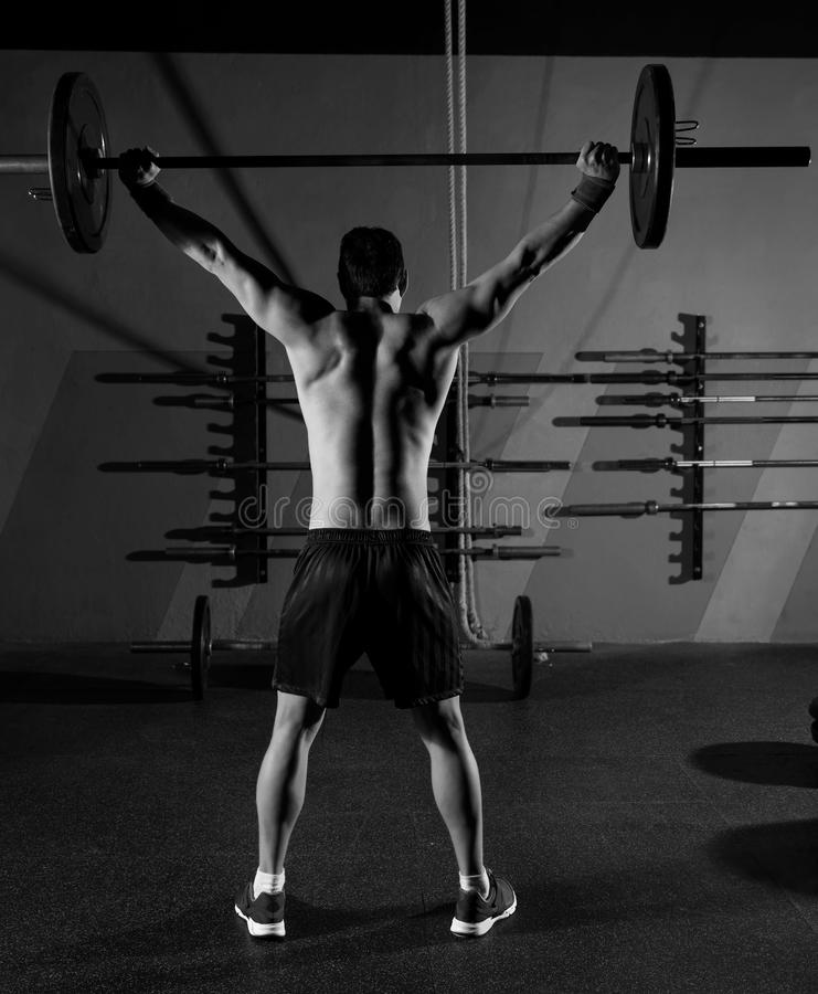 Barbell weight lifting man rear view workout gym stock photo