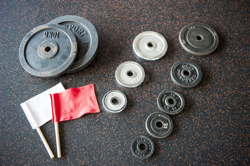 Barbell weights plates with arbiter flags royalty free stock images