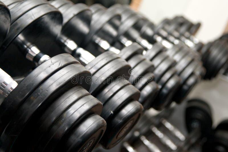 Barbells noirs à la gymnastique photographie stock