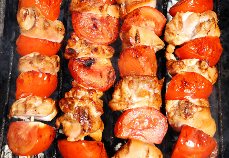 Barbeque with chicken and tomatoes royalty free stock photo
