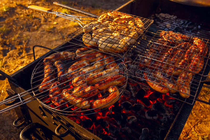 Barbeque grill sousage cooking royalty free stock images