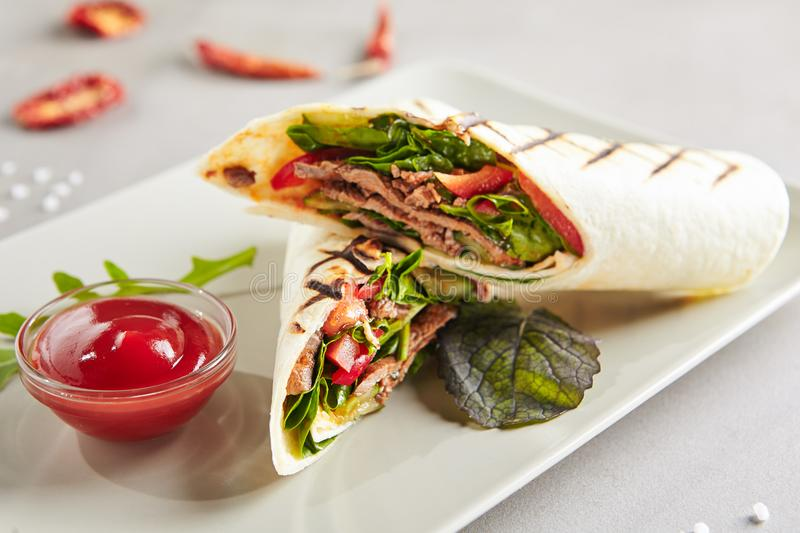 Meat Shaverma, Gyro or Doner Kebab with Vegetables stock photography