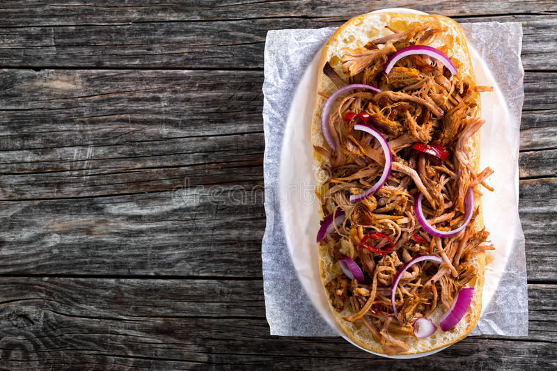 Barbeque Pulled Pork ciabatta open Sandwich, top view stock image