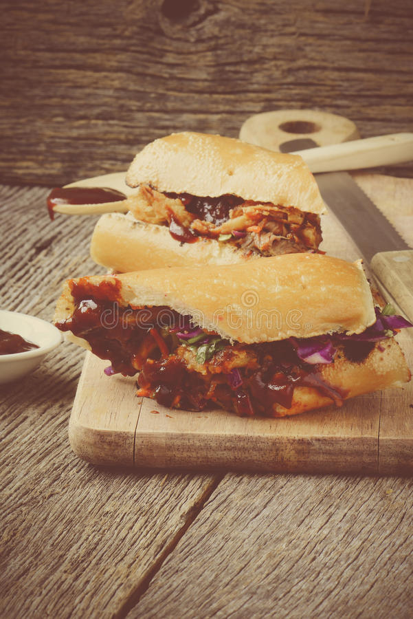 Barbeque Pulled Pork Sandwich with BBQ Sauce stock images