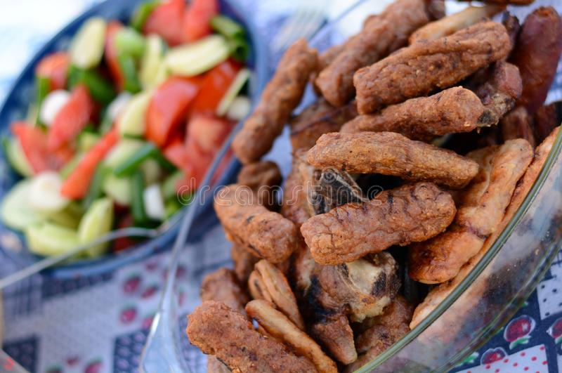 Barbeque and salad stock images