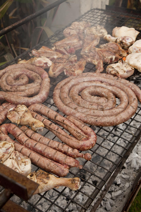 Barbeque. A selection of meats on a coal fire grill, as is traditional in South Africa, where it is referred to as a braai, a traditional word for barbecue stock image