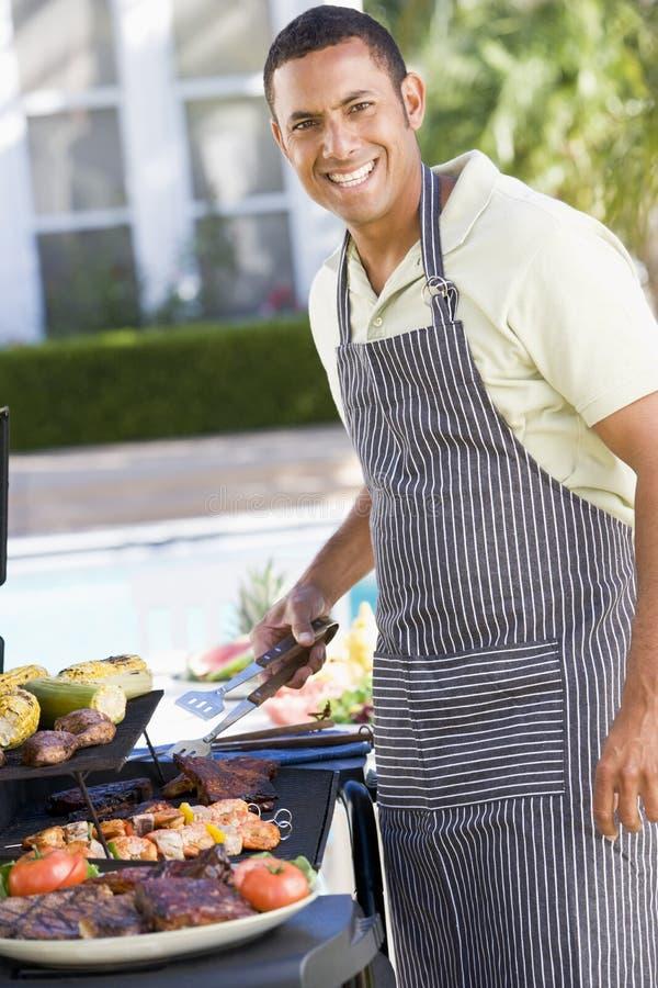 barbequed tycka om trädgårds- manmål royaltyfri bild