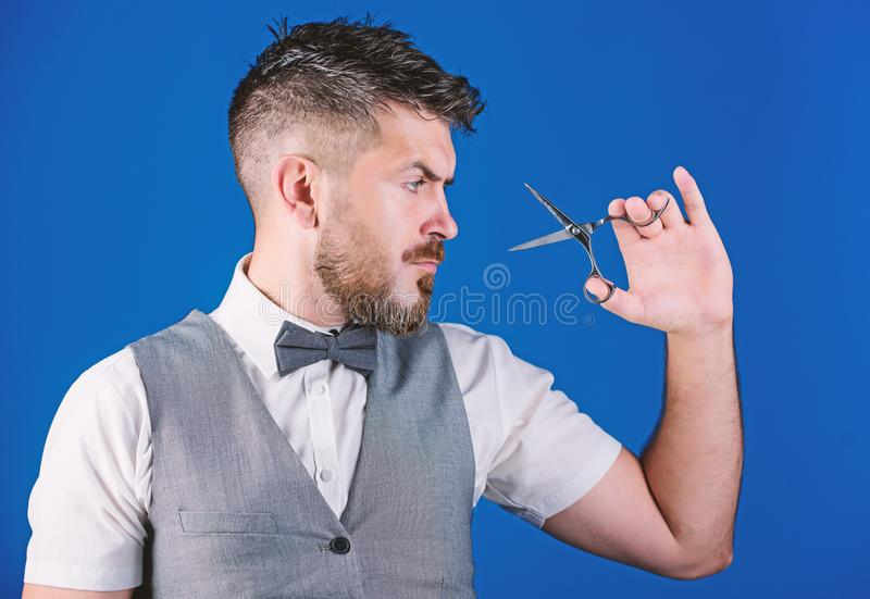 Barber with beard and mustache hold steel scissors. Grooming beard. Create your style. Macho bearded barber hold. Scissors cut hair. Barbershop service concept stock photos