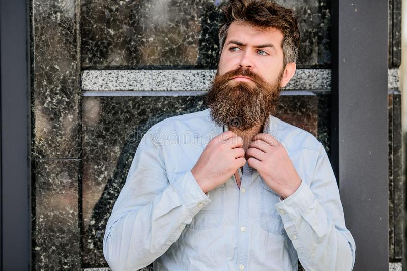 Barber concept. Beard grooming. Beard care. Masculinity and manliness. Man attractive bearded hipster posing outdoors. Confident posture of handsome man. Guy stock image