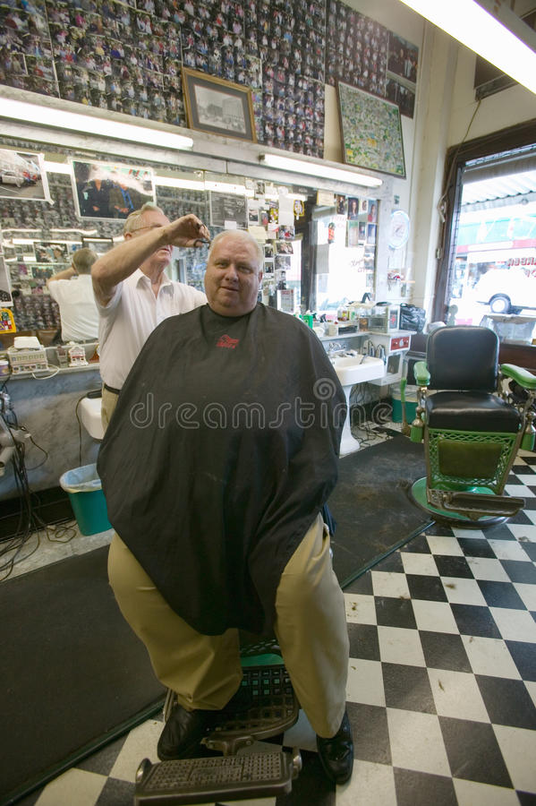 Barber cutting hair. Floyd cutting hair at Floyd's City Barber Shop in Mount Airy, North Carolina, the town featured in �Mayberry RFD� and home of Andy stock images