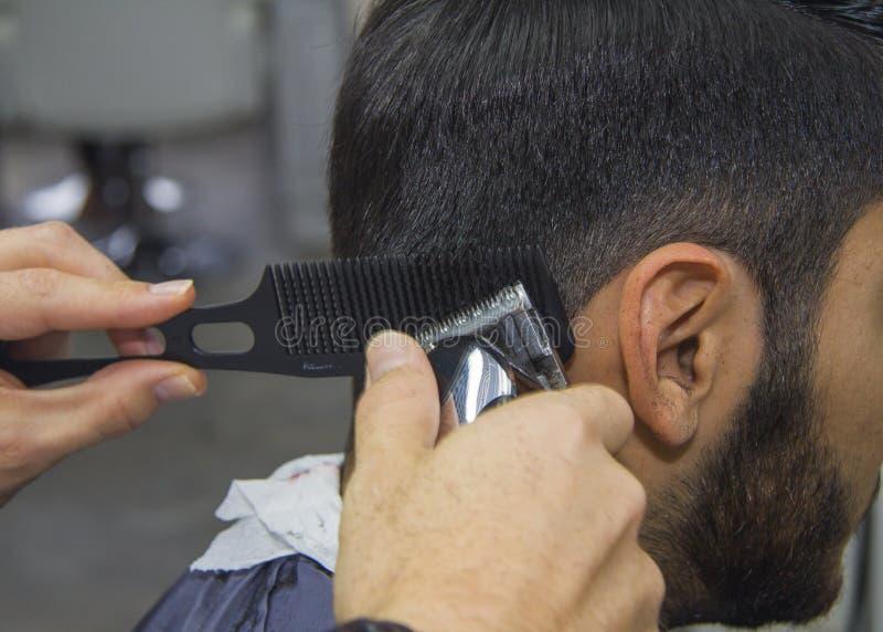 Barber cutting hair stock photos