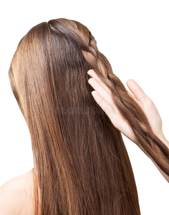 Barber girl braids the long hair in braid isolated. Barber girl braids of the long hair in a braid isolated on white background royalty free stock images