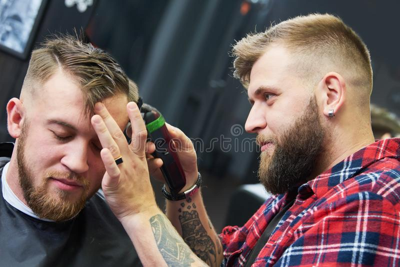 Barber or hair stylist at work. Hairdresser cutting hair of client stock photos