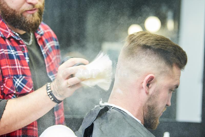 Barber or hair stylist at work. Hairdresser using talc stock images